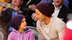 David Beckham and his son Romeo attend LA Lakers game. Congrats to Romeo--the new face of Burberry Childrenswear!