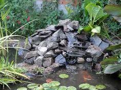 Resultado de imagen de estanques de jardin con cascadas