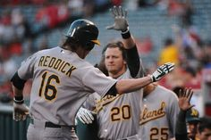 ANAHEIM, CA - MAY 14: Josh Reddick #16 of the Oakland Athletics celebrates after scoring a home run against the Angels of Anaheim in the first inning at Angel Stadium of Anaheim on May 14, 2012 in Anaheim, California. (Photo by Jonathan Moore/Getty Images)