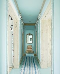 Beach Staircase/Hallway by Miles Redd in Lyford Cay, Bahamas. Note hall is lined with plaster palm trees. Paint - Benjamin Moore. Runner - IKEA rugs sewn together.