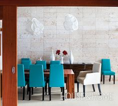 This Caribbean dining room truly brings the outdoors in with pale coral stone walls and light porcelain slab floors. | Photographer: Virginia Macdonald | Designer: Rafael Selman