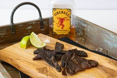 Fireball whisky bottle behind beef jerky on cutting board with two lime wedges Fireball Recipes, Alcohol Recipes, Drinks Alcohol, Jerky Recipes, Snack Recipes, Snacks, Beef Recipes, Teriyaki Beef Jerky, Farmers Casserole