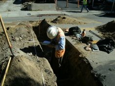 Documenting an exposed Mission era cultural deposit within a utility trench under Chorro Street in San Luis Obispo, California. DSMc.2008