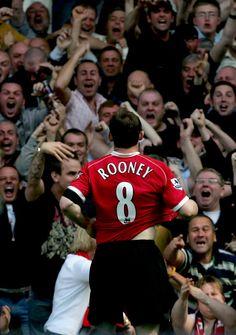 Wayne Rooney celebrates scoring against Everton with the @manutd fans at Goodison Park.