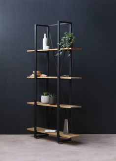 Industrial Overhang Shelving All about the balance... The new Overhang Shelving is made from a box section, mild steel frame and European Oak shelves. The overhanging oak boards give it a lighter look. Lovely! This bookcase is available with either matt black steel, or raw lacquered stee