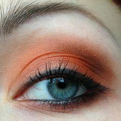 Bright orange eye make-up look.