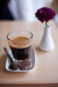 A tiny, super sweet, chocolate cookie tacked by your bitter coffee