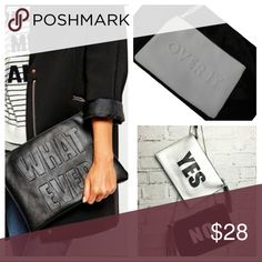 """Slogan Clutch Super Chic """"Over It"""" slogan zip clutch w/ wristlet strap.  Vegan leather finish. 11.5 by 8 inches. Black interior with one large side zip pocket. So cute! Looks great with daytime and night out looks. Have fun with your fashion and mix it up with this amazing """"memorable moments"""" slogan clutch. <3 NWOT Bags Clutches & Wristlets"""