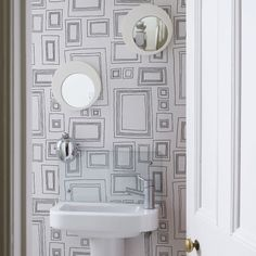 lovely idea with graphic wallpaper as a nice accent for white bathroom