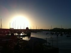 Sunset in Las Galletas Tenerife with Fishing Boats in the Harbour.