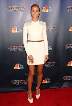 """Heidi Klum was pure perfection with a long-sleeved Versace white minidress with gold details and a gold belt at """"America's Got Talent"""" post-show in NY. #VersaceCelebrities #Versace"""