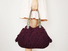 Purple crocheted bag with 'bobble and diamond details, fitted with grey leather straps.