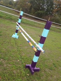 Diy horse jump standards! Very simple to build and use for schooling. 10 ft 4x4 cut in two. Use 2x4's for the base as long as you want them. Paint the way you want and drill holes for jump cups to your desired heights. (I used 5/8ths wooden dowels from wal mart and drilled a 5/8ths hole about 2 in. deep into standard.) Put the dowel in with wood glue and left it sticking out about 4 in. Easy and cost less than $20 to make the set!