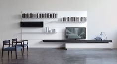 Amazing Wall Storage Items For Your Contemporary Living Room - Floating wall storage is a mixture of sensible storage and residential décor vogue the place the storage unit is mounted to the wall and is used to handle CDs and DVDs. Floating Wall Shelves, Wooden Shelves, Things Organized Neatly, Living Room Wall Units, Interior Architecture, Interior Design, Shelf Design, Wall Storage, Decoration