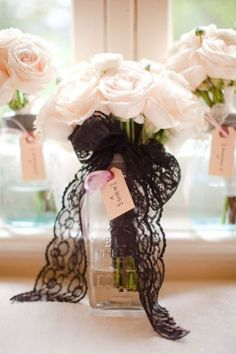 This could be quite lovely as a simple centerpiece! Pink roses and simple black lace!