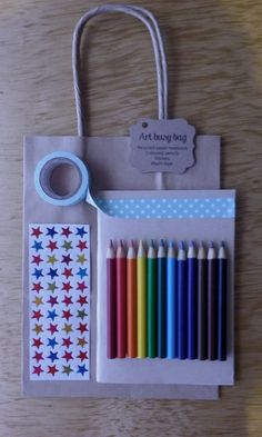 Art busy bag ($10.00)  Contents: mini scribble book, pack of 12 mini colour pencils, rainbow star stickers and washi tape (design may vary from picture shown)