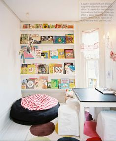 Chic Kids' Rooms. A playroom with a giant bean bag chair and built in bookshelves.