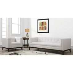 Anchor your parlor or living room ensemble with this understated sofa, featuring a streamlined silhouette and gently tufted upholstery.