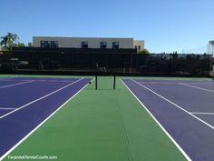 Purple tennis courts with green surround at Bishop's School.