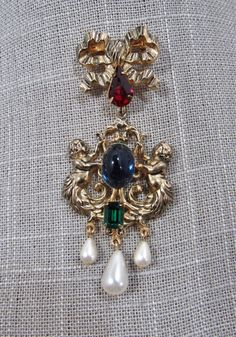 Gorgeous retired Kirks Folly goldtone rhinestone cabochon hanging brooch with tear drop pearls by Carolannstudios on Etsy https://www.etsy.com/listing/547697286/gorgeous-retired-kirks-folly-goldtone