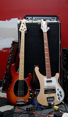 Musicman Stingray & Rickenbacker bass guitars.  I played bass in high school garage bands. I wanted a Rickenbacker but couldn't afford it. After high school I got a factory job. Music man had just released the Stingray. I fell in love with it. I owned a tobacco sunburst identical to the one on the left.