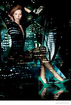 More Jimmy Choo Cruise–Following up a preview, Jimmy Choo has released even more photographs from its cruise 2015 campaign starring Ondria Hardin. The American model poses for Mat Collishaw in the pre-season styles including sexy heels and glittering bags. The city skyline reflects in the background as well as on the model in the new advertisements.    ...