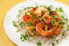 A quick meal of stir-fried shrimp tossed with spicy tomato-based sauce and served on a bed of cellophane noodles.