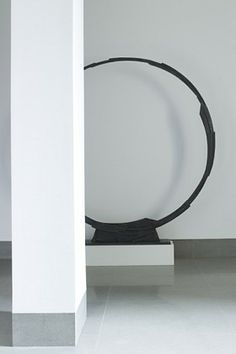 Elegant art installation inside a modern interior designed by Piet Boon _