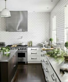 Love the open feel with an industrial edge.  Mix in more classic materials and a bit of grey, pink color with the white, wood, and green.