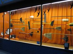 Halloween window at Cole Hardware. Add the woof and poof riding the brooms!!!