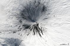 """Of the roughly 1,550 volcanoes that have erupted in the recent geologic past, 113 are found on Kamchatka. Forty Kamchatkan volcanoes are """"active,"""" either erupting now or capable of erupting on short notice. The Operational Land Imager (OLI) on Landsat 8 captured activity at five of them during a single satellite pass on April 14, 2014."""
