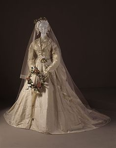 Silk taffeta wedding dress and Brussels net veil, English (Liverpool), 1868.