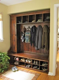 tall door-ed cabinet on one side......looks like piece of furniture almost