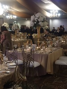 Orlando Family Foundation Event. Champagne Lamour Linen. Gold La Corder Chairs with White Seat Cover. Weinhardt Party Rentals.