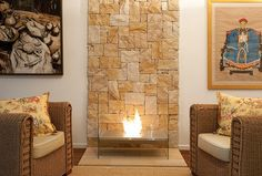 No chimney needed: vent free fireplace by EcoSmart. I love the stonework that frames it so beautifully.