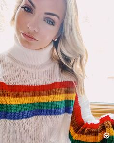 Ski towns are the  best for rockin' funky sweaters! This fun rainbow sweater is a Ski Trip Outfit MUST!
