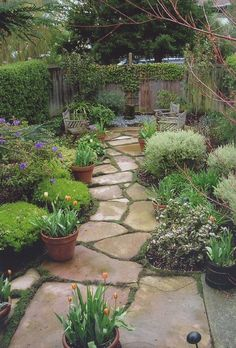 Flagstone path, pots, benches ~ not a bad idea for my front lawn ~ I can use the preformed mold I have to make a flagstone looking path.