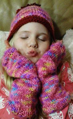 Hat and wrist warmers knit in cherry yarn, both done by Jodi Villanella