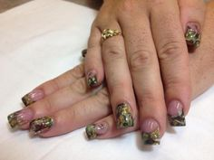 These fall acrylic camo nails were designed using real twigs, leaves, and moss!