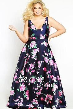 75ec9cdef73 You re sure to be a trendsetter at Prom 2018 in this must-have floral satin  print dress designed to flatter plus size teens.