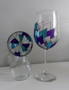 Hand painted purple and teal pinwheel wine glasses.