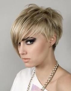 Im thinking of going short! Short Pixie Hair Style for Women Trends 2012 Pictures