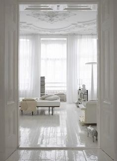 high gloss floors contrast with louis xiv ceilings to make me feel strange down there.