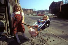 A young girl pushes a baby wagon with a doll in Eisenach.