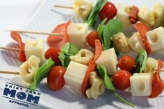 Nothing says party like appetizers on a stick. This combination of pasta, meat, cheese and veggies are practically a meal in itself and the vibrant colors match the holiday décor and spirit. A crowd pleaser for all ages!