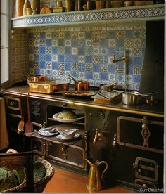 wonderful mismatched tiles in his blue and white kitchen!