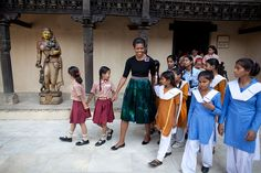 First Lady Michelle Obama, accompanied by children from low income communities in the region, tours the National Craft Museum in New Delhi, India, Nov. 8, 2010. (Official White House Photo by Chuck Kennedy)