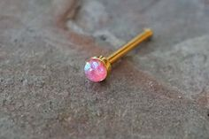 "Rose gold nose ring. Rose rold nose stud with a 2mm pink opal gem. 20 gauge nose ring, 1/4"" long post, made of 316L surgical steel plated rose gold with a tiny synthetic pink opal stone is discrete ye"