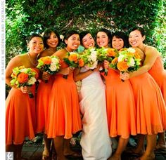 The bridesmaids wore strapless, chiffon dresses in a lively orange hue. Each woman also carried a bouquet comprised of orange, ivory, and green peonies and roses.