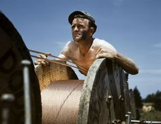 A construction worker helps build a new power line into the rapidly growing installation. (Photo via�Library of Congress)  via @AOL_Lifestyle Read more: https://www.aol.com/article/news/2017/03/02/spectacular-color-photos-capture-wwii-tank-crews-in-training/21721594/?a_dgi=aolshare_pinterest#fullscreen